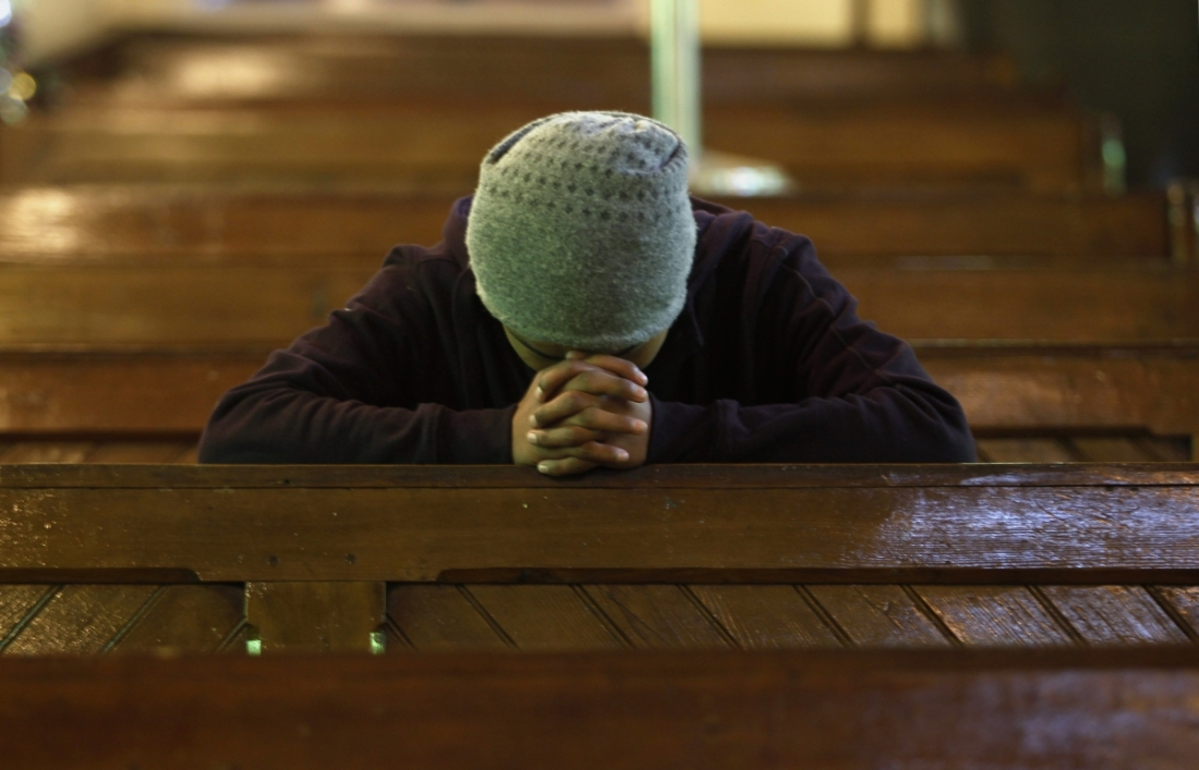 praying-in-church-in-india