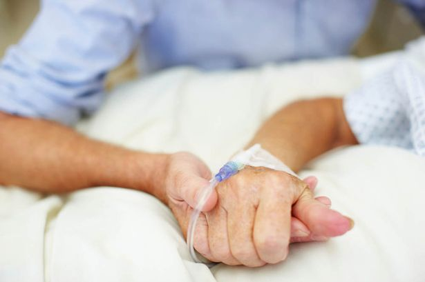 Reassuring-patient-in-care-by-holding-hands