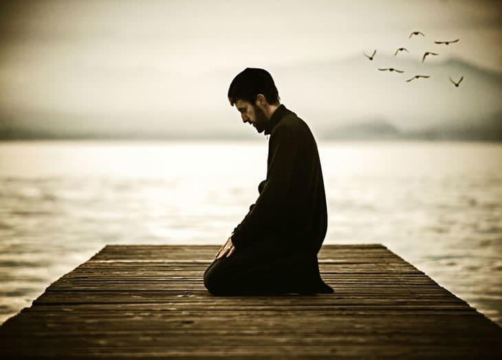 man-praying-dock