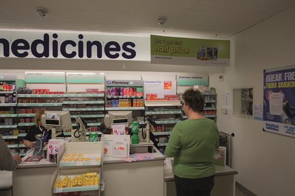 1074023_pharmacy-counter-patient-pharmacist-al-17